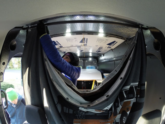 The privacy curtain which allows no creepers to be peeping while be are sleeping (This is looking into the windshield